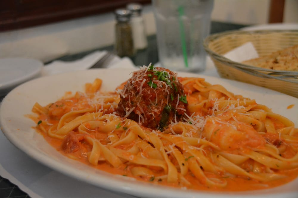 Fettuccine with a large meatball and shrimp pink sauce on for Mammas italian kitchen