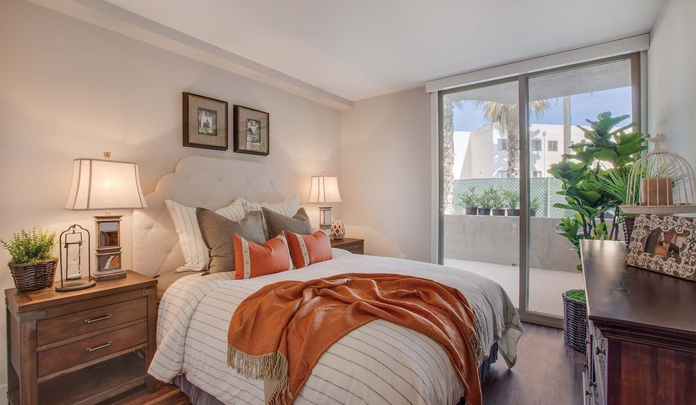 Spacious Bedrooms Offer Wood Flooring And Sliding Doors With Direct