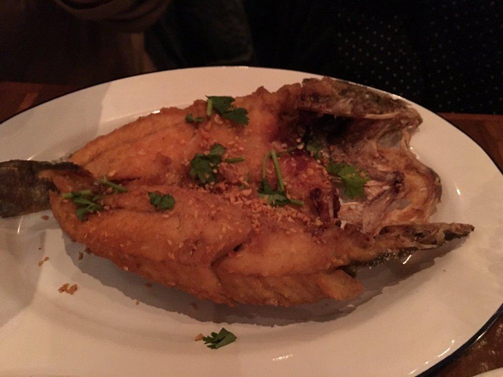 Crispy garlic branzino with fish sauce yelp for Fish cheeks nyc