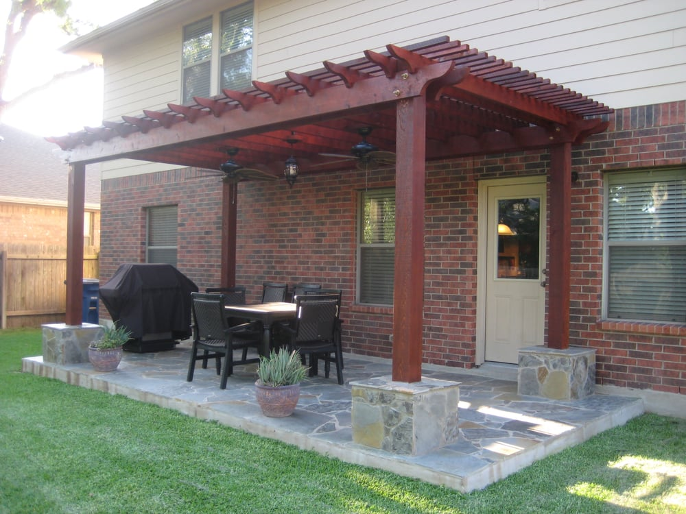 Photo of Austin Yard Builder Masonry Contractor - Austin, TX, United States. cedar wood pergola and stone patio