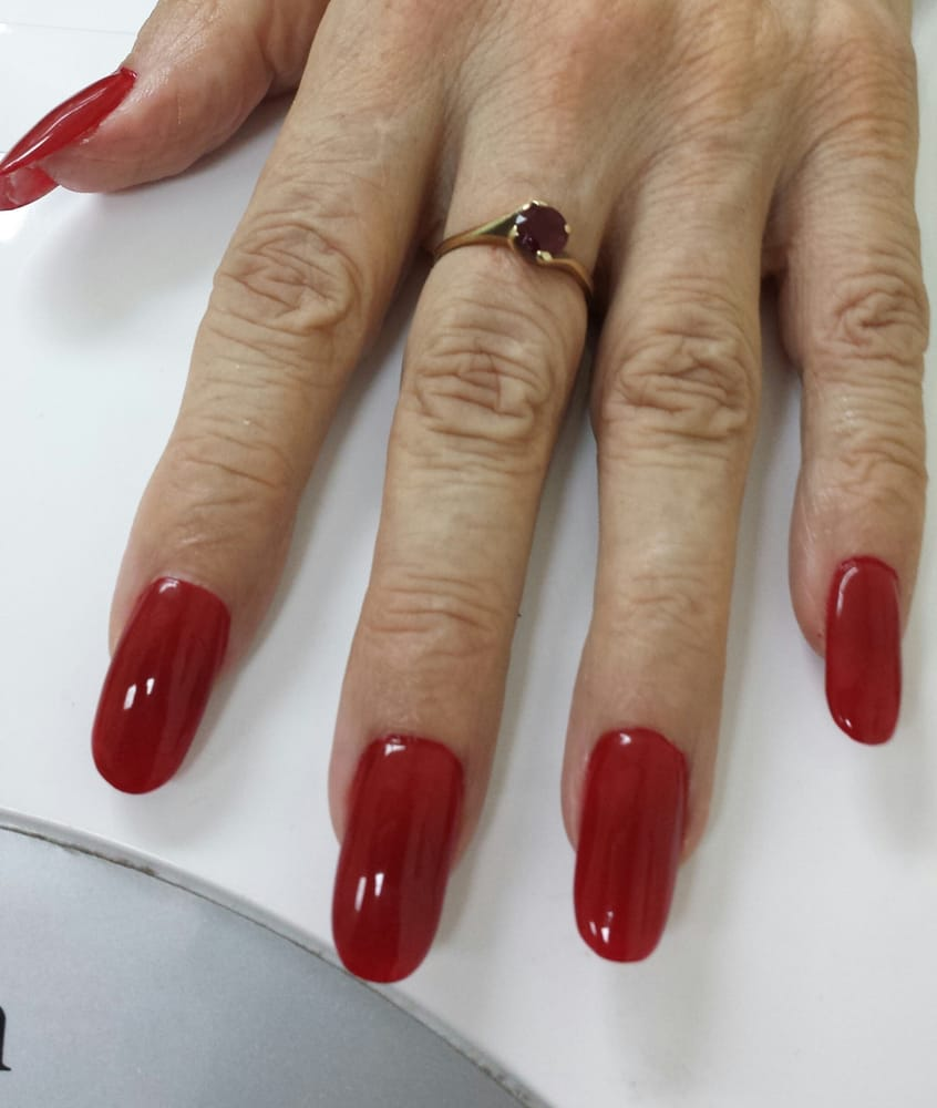 Round Shaped Acrylic Nails With Red Polish And Gel Top