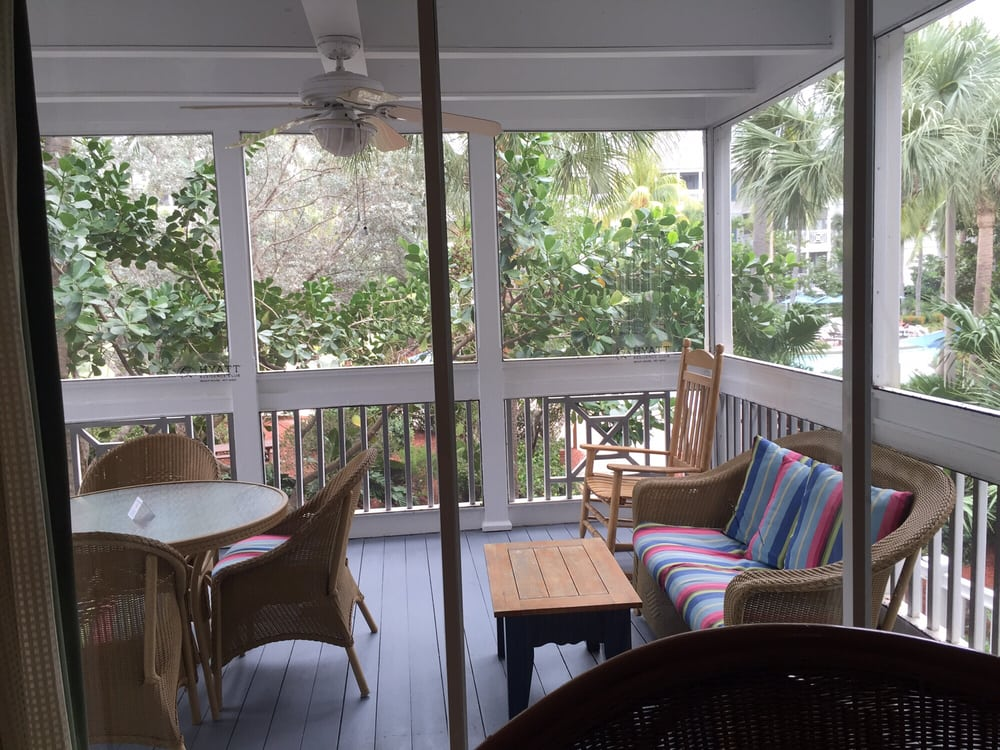 Screened in porch equipped with ceiling fan. - Yelp on key west color palette, key west cottages, key west design, key west florida homes, key west bungalow decorating,