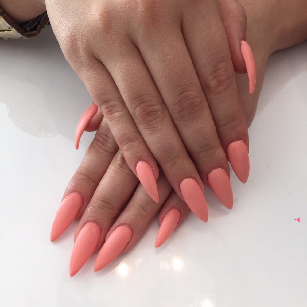 Beautiful stiletto shaped nails with the perfect summer matte peach ...