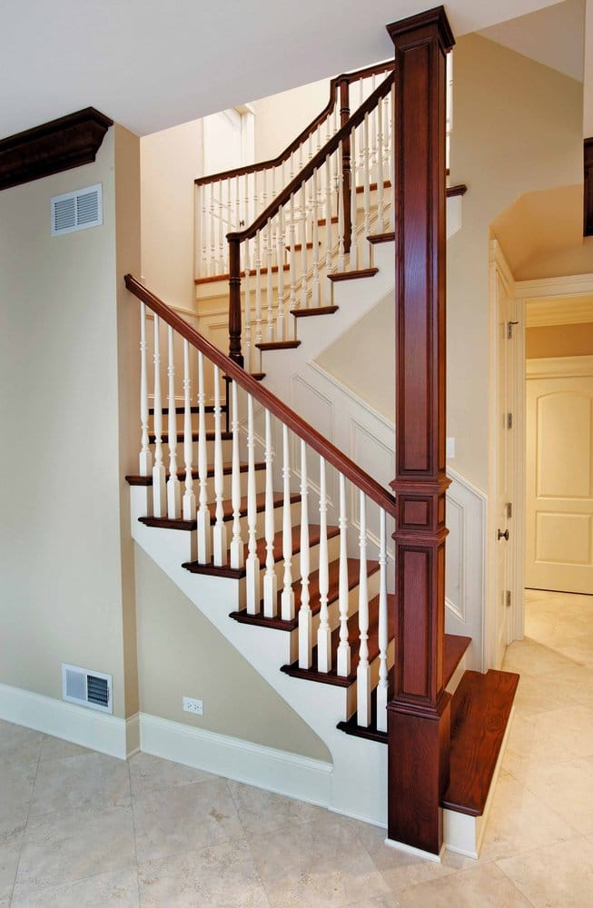 U Shape Stair With Wood Baluster And Column Wrap That