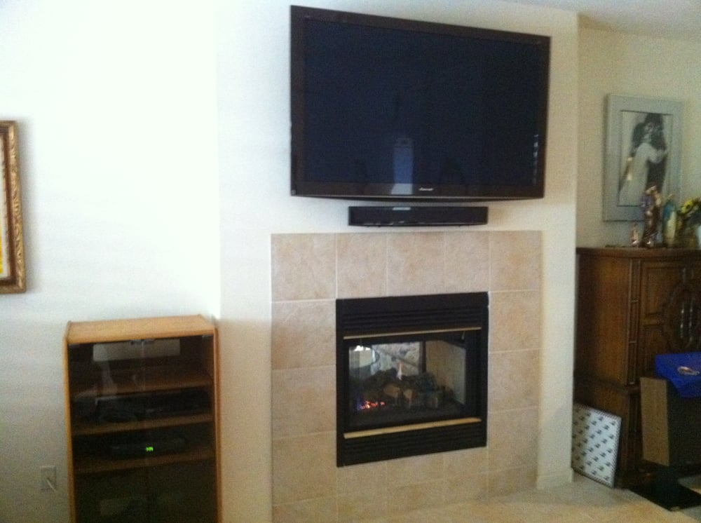 Flatscreen tv fireplace wall mount w component cabinet yelp for Wall mounted tv enclosure