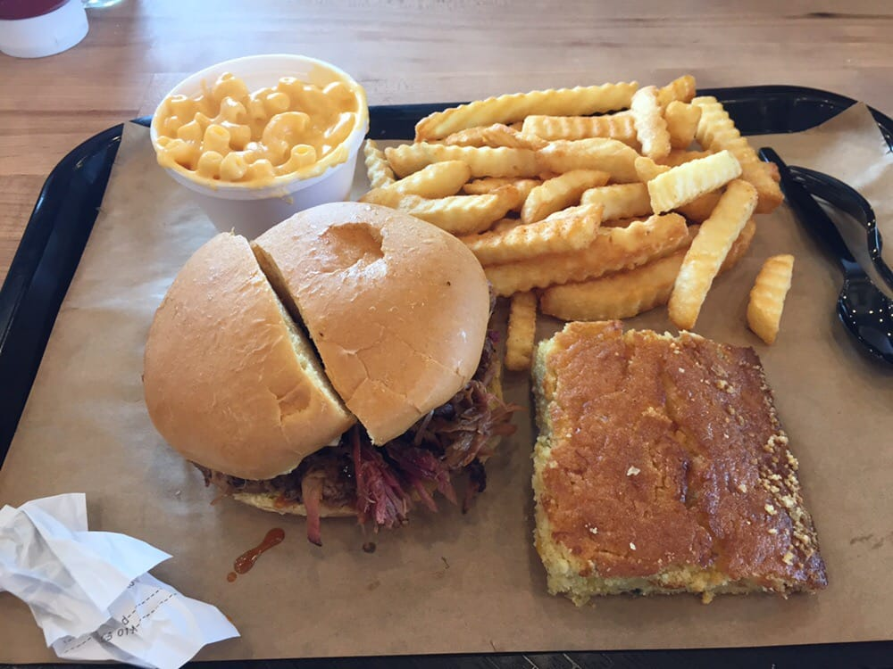 Pulled Pork Sandwich With Fries Cornbread And Mac N