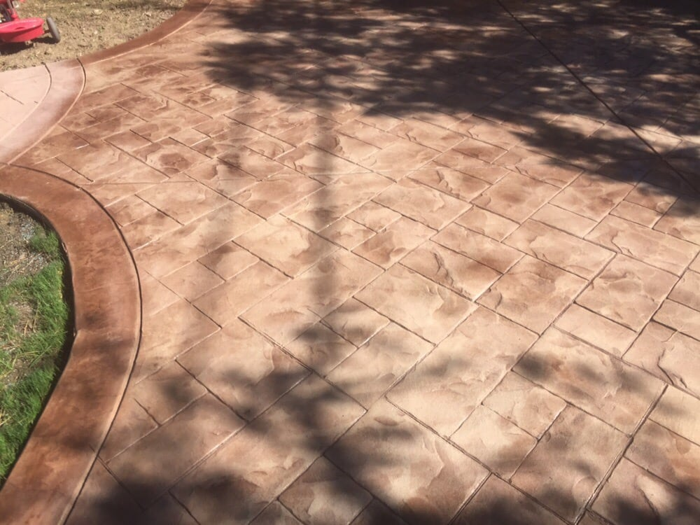 Pebble colored concrete with chestnut powder stain - Yelp