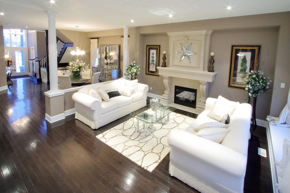 Dark Flooring Contrast Nicely With The Beige Pallet And