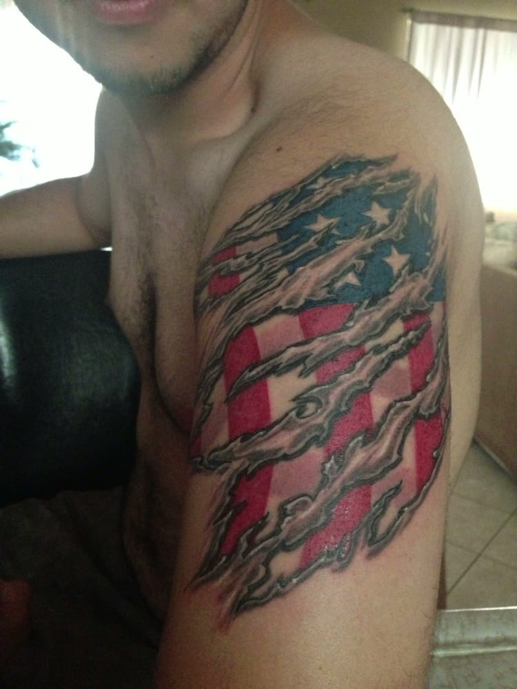 American flag tearing through my shoulder yelp for Jobs that allow piercings tattoos and colored hair