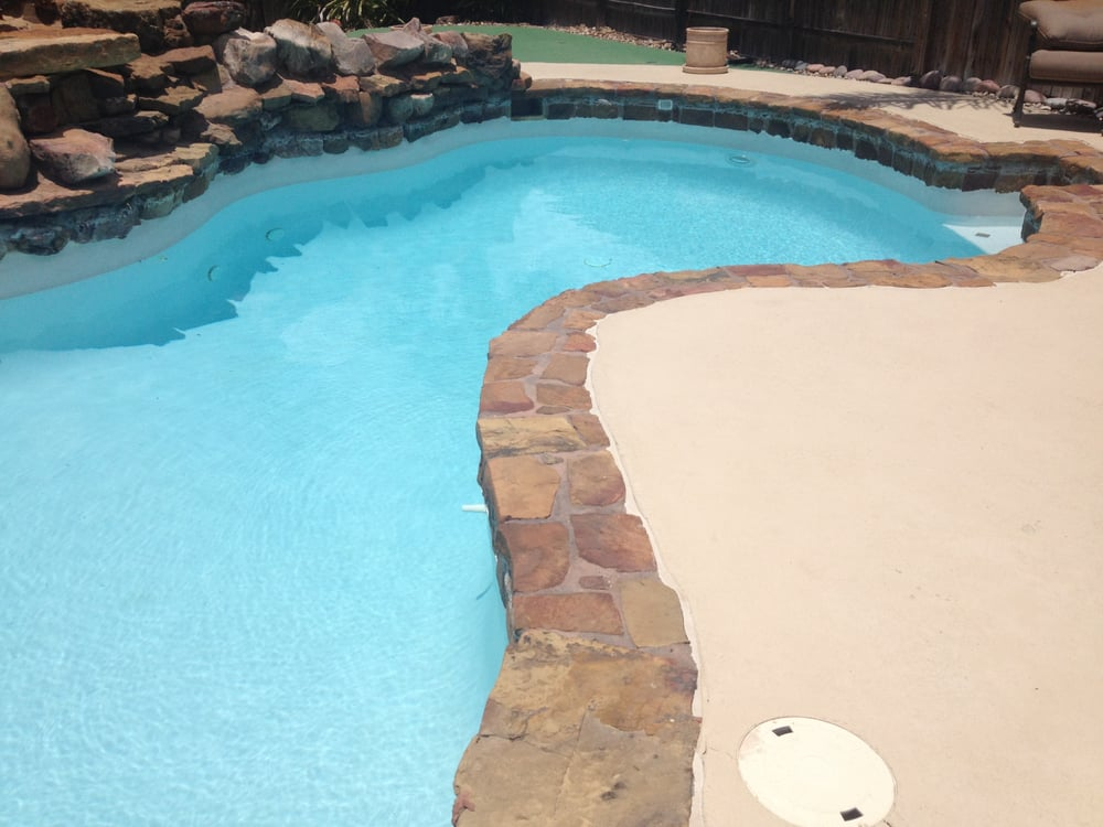 Flagstone pool coping surrounding salt water swimming pool for Natural stone around pool