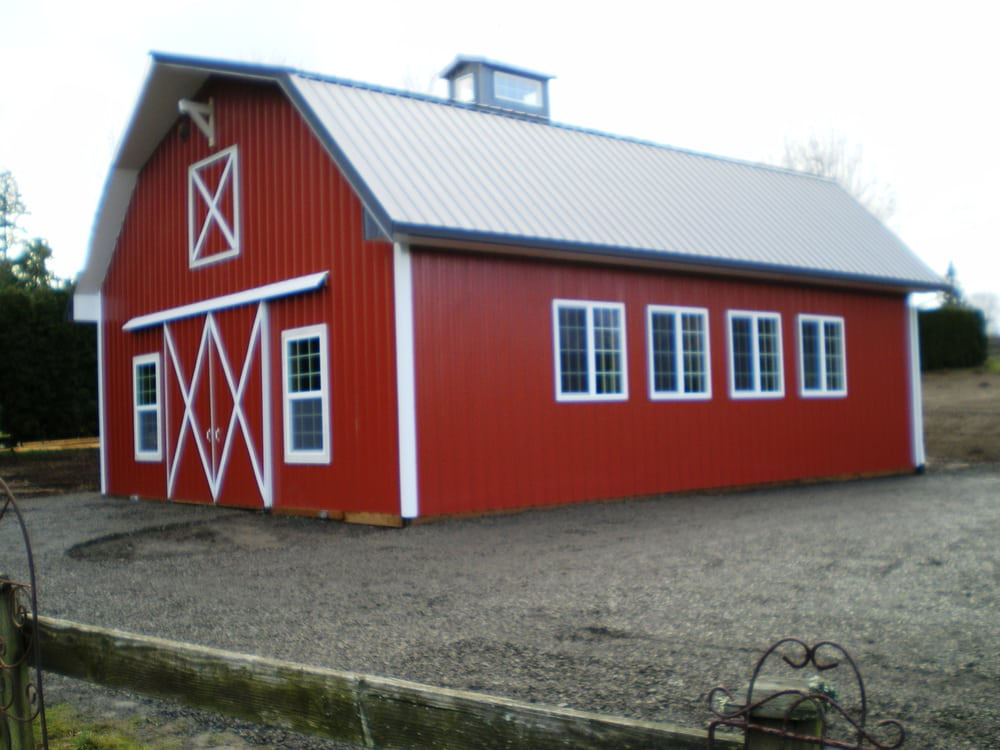 Nice gambrel style barn with plenty of windows for natural Gambrel style barns