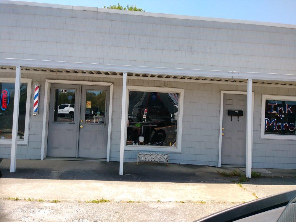 Lisa's Barber Shop: 401 Main St, Warrior, AL