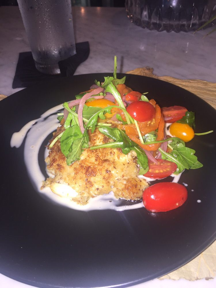 Crab cakes with pickled onion greens and cherry tomatoes for Tybee island fishing report