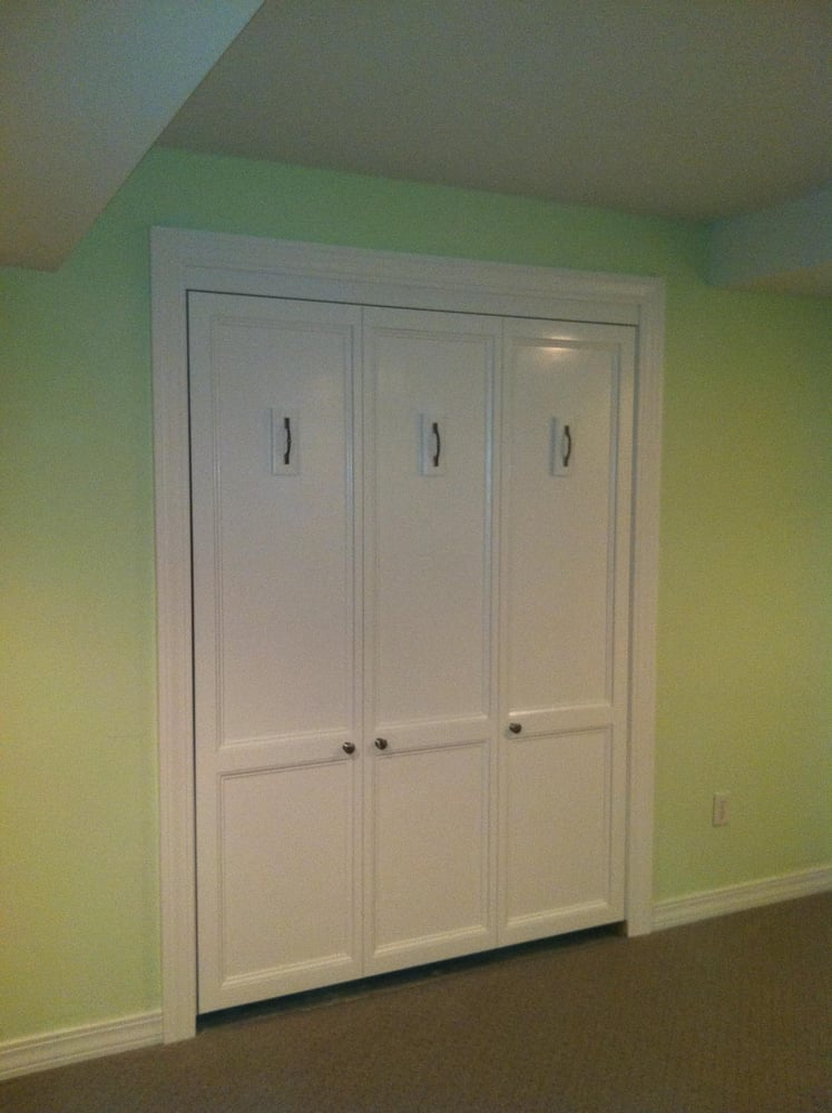 In this finished basement I built a Murphy Bed to fit into wall