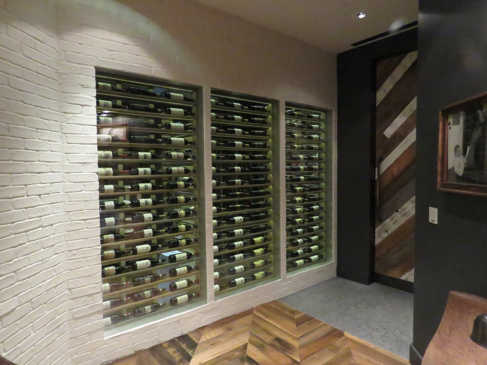 The wine rack backs onto the private dining room yelp for O bar private dining room