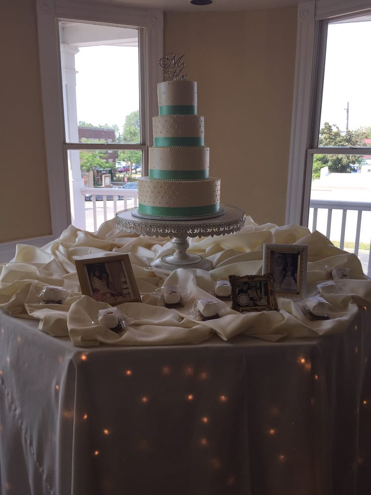 Set up of wedding cake table. July 2015 wedding - Yelp