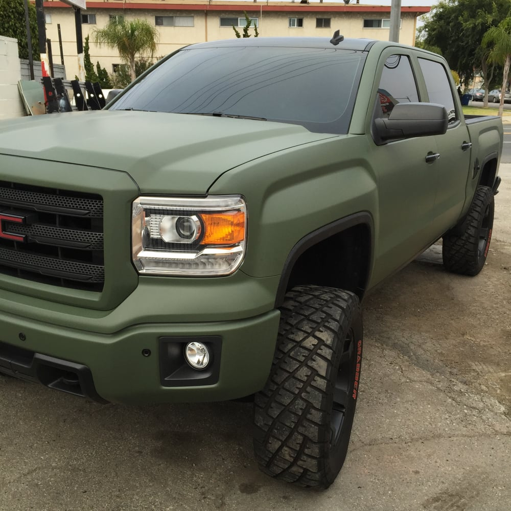 Full Vinly Wrap On This 2014 Gmc Sierra Camo Green