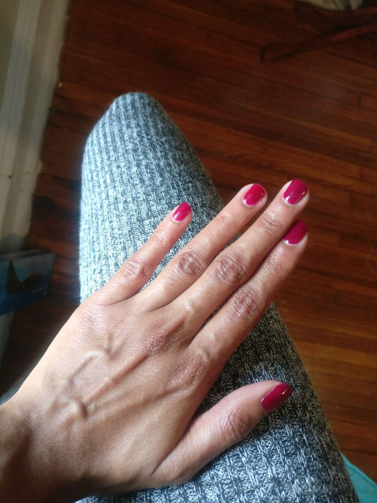 Gel manicure in elegant red color. Going to this place again for a ...
