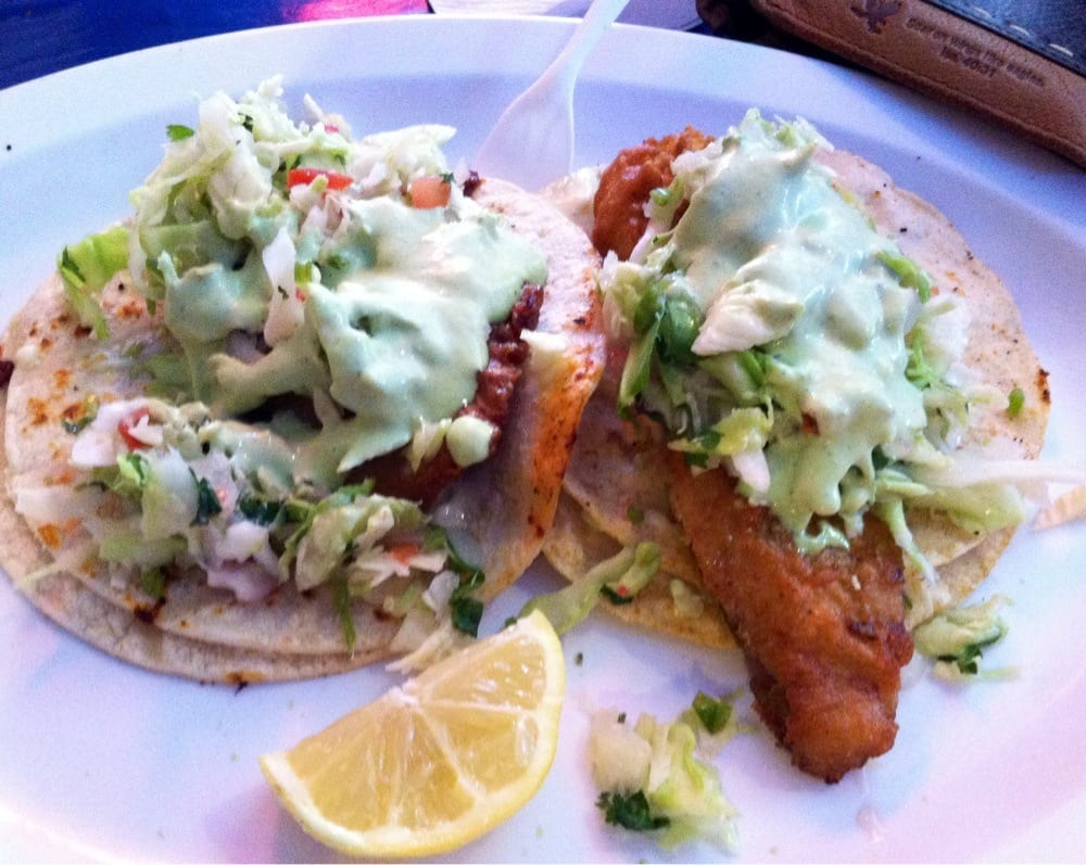 2 fish tacos big on left bigger on right delicious for Fish tacos near my location