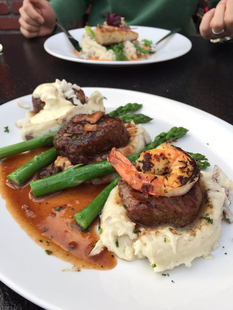 Filet Mignon Trio has shrimp scampi, Oscar-style, peppercorn brandy sauce, asparagus, roasted ...