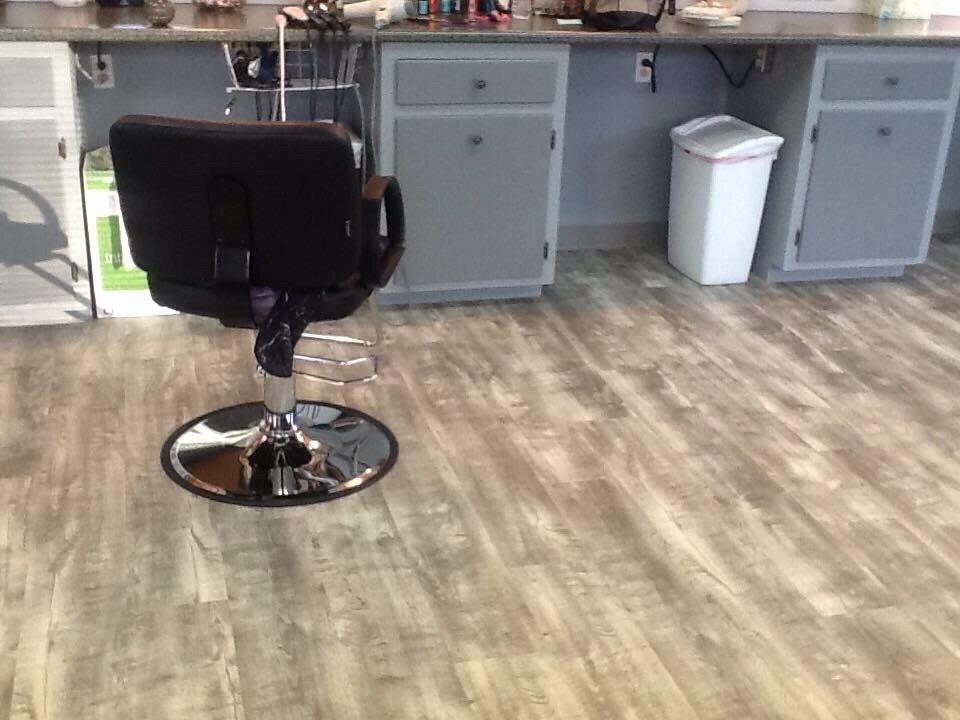 The Hair Hut: 422 N Wayne St, Angola, IN