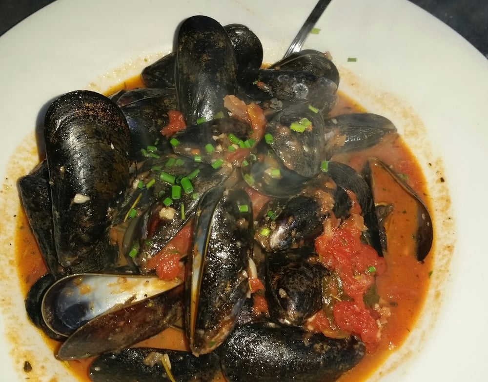 ... States. Steamed mussels with tomatoes, garlic, parsley, and wine