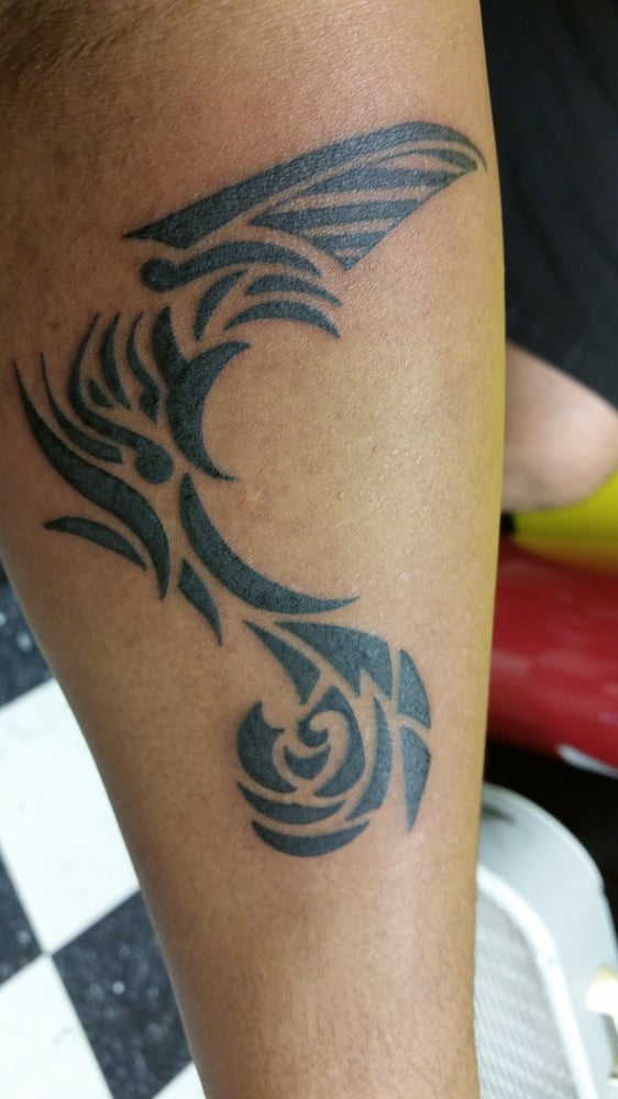 My own design modified by tino to make it have more of a for Tattoo shops in waikiki