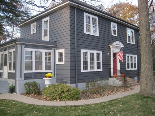 slate grey siding with stark white trim for contrast works great on this older colonial style