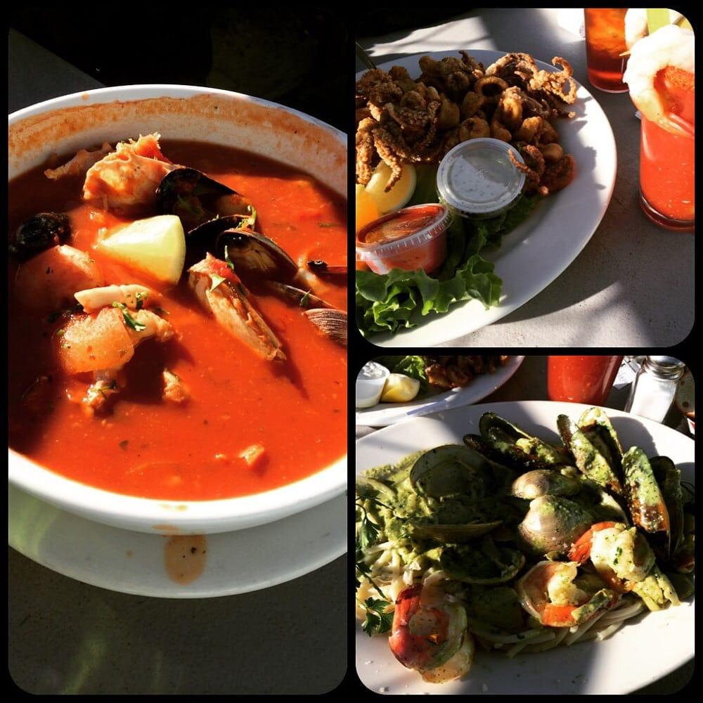 Cioppino calamari and seafood pasta in pesto cream sauce for Phil s fish market