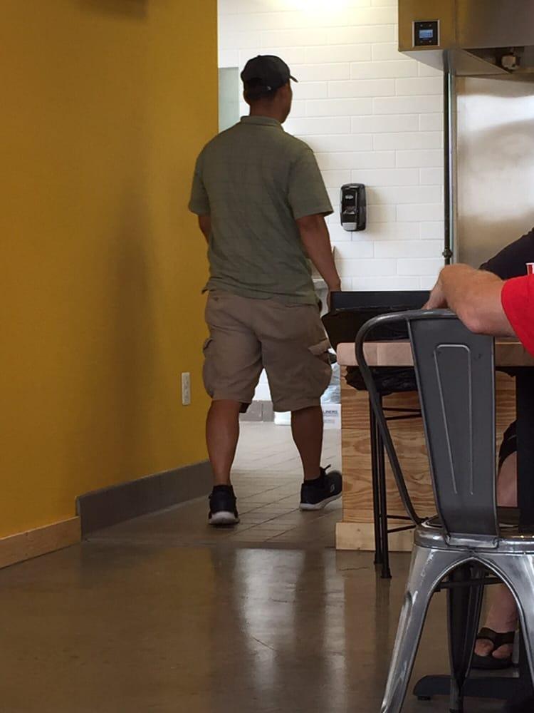 Man Walking Into Restaurant Kitchen