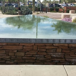 Triangular reflecting pool a common pattern in his desert for Common pool design xword