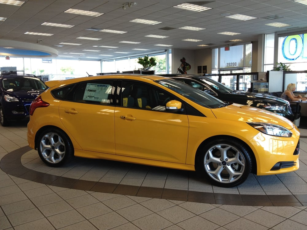 2013 ford focus st in tangerine scream on our showroom. Black Bedroom Furniture Sets. Home Design Ideas