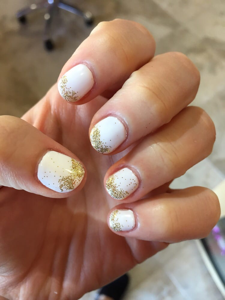 White gel nails with loose gold glitter added. - Yelp