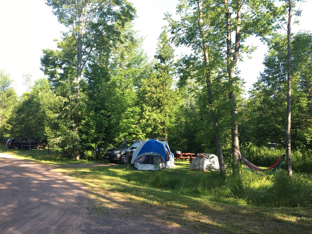 Photo of South Shore C&ground - Cornucopia WI United States. Primitive tent c&site & Primitive tent campsite with picnic table and fire ring. - Yelp