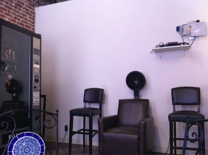 Vending machine and hair dryer chairs in the waiting room for 18 8 salon pasadena