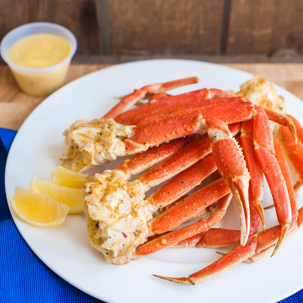 Snow crabs tossed in butter garlic or spicy butter garlic for Fish market tampa