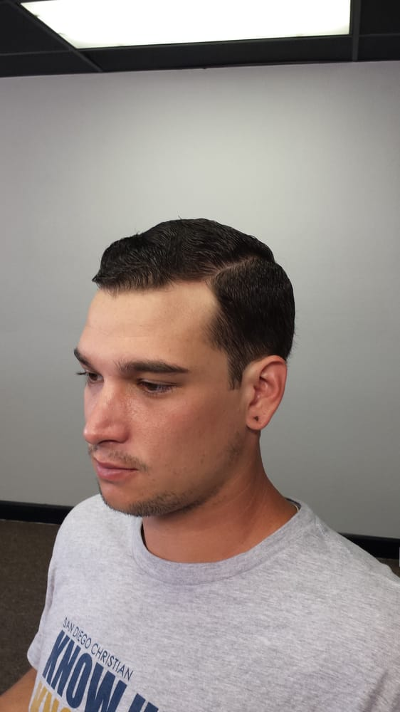 Regular haircut. Number 2 on the sides. Finished with a ...