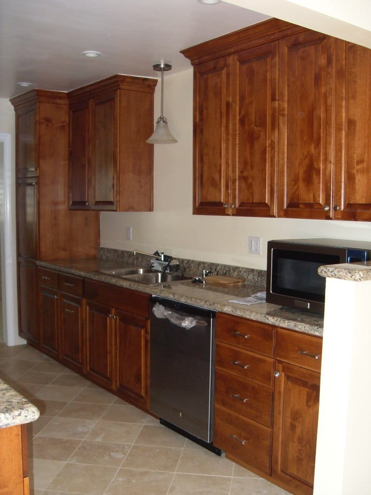 Much better knotty alder cabinets gorgeous granite tops for Reliable remodeling