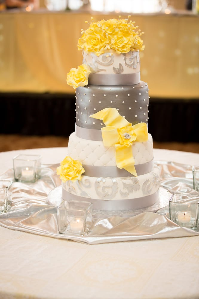 Wedding Cake With Silver White And Yellow Colors And