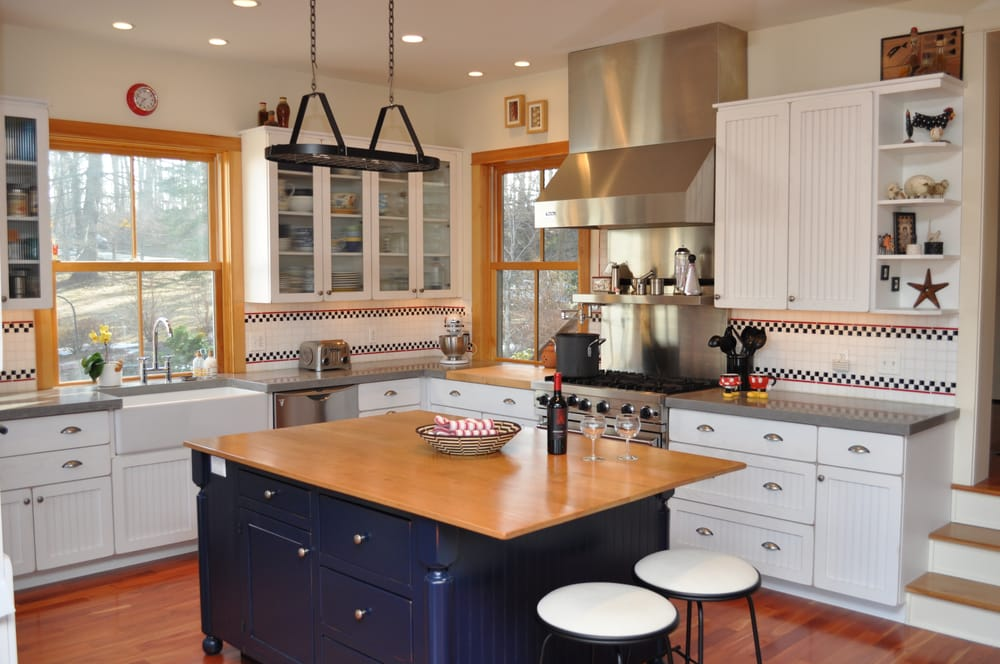 White oak cabinetry with custom concrete countertops yelp for Builder oak countertop
