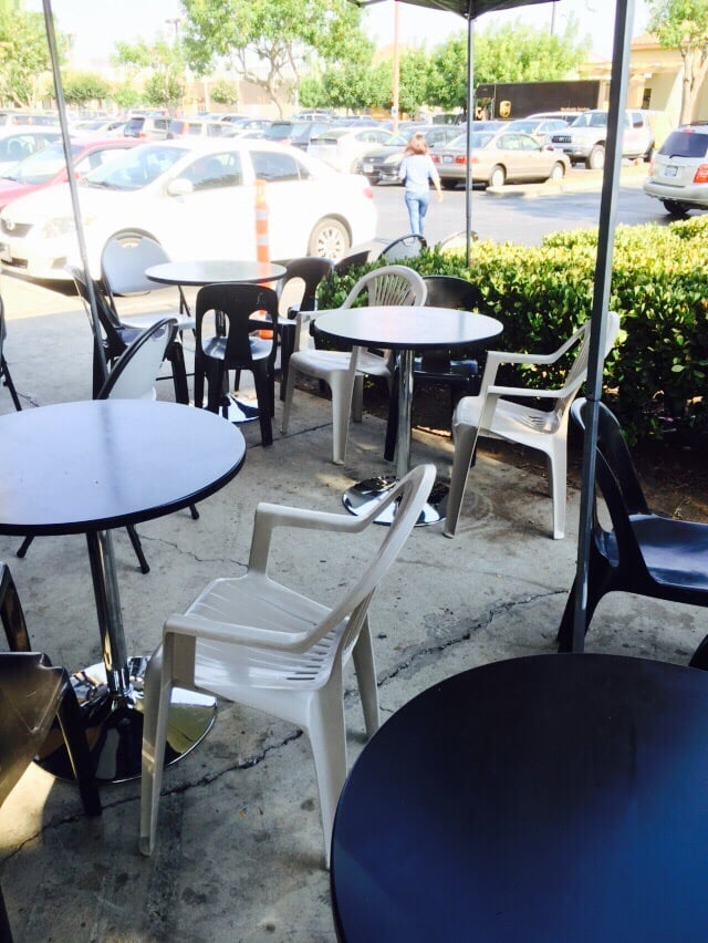 About 7 Of These Small Tables Right In Front Of It Yelp