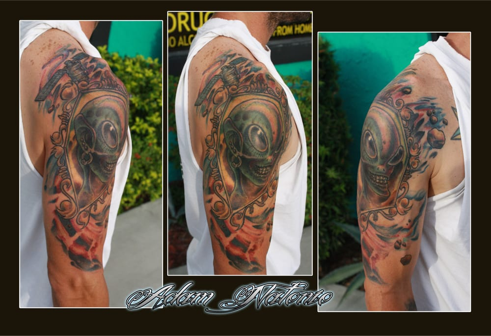 Alien and space mural positioned on right arm yelp for Arm mural tattoos