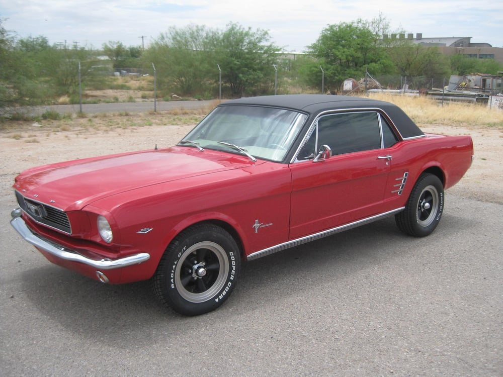 A 1966 Ford Mustang Painted 66 Candy Apple Red With Black