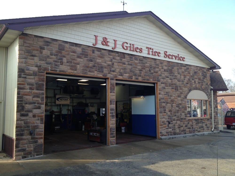 Giles Tire Service: 231 W Superior St, Alma, MI