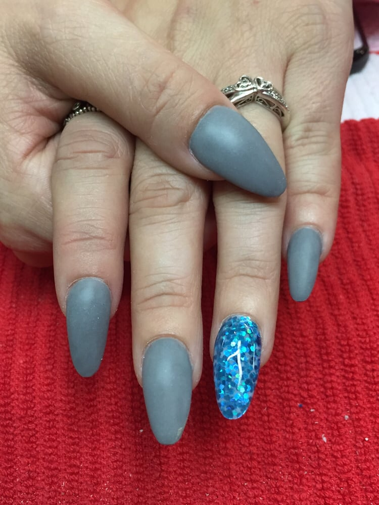 Matte gray acrylic nails w chunky turquoise glitter accent for 50th avenue salon