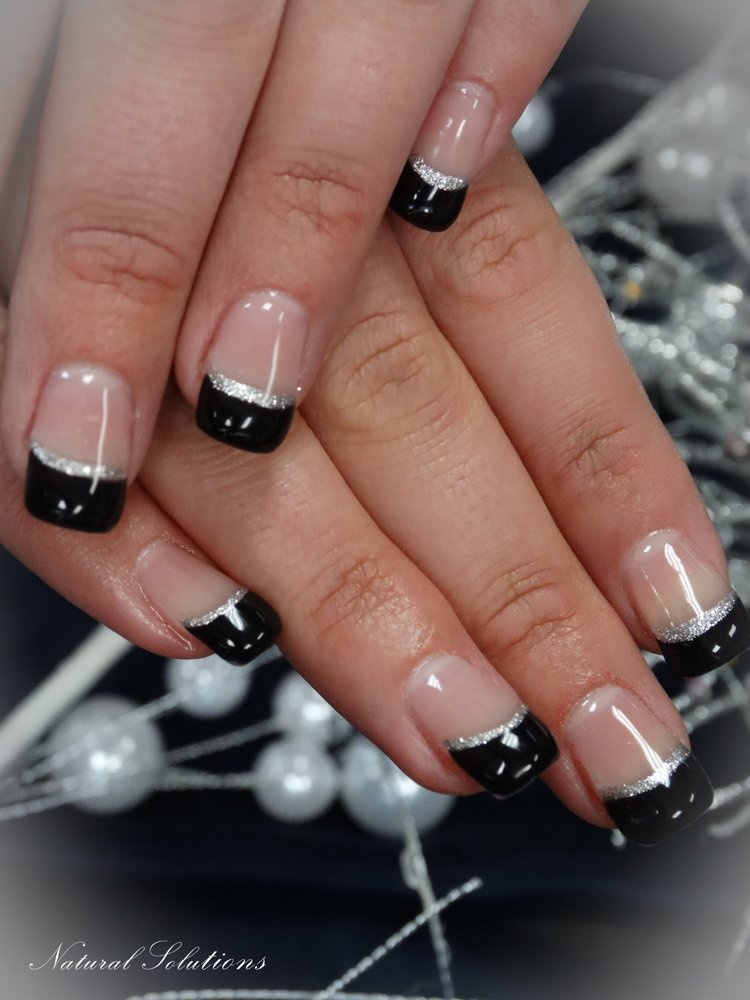 Gel services with full set of nail tips designed with black tip and ...