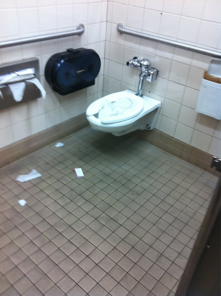 Bathroom Yelp gross restroom. filthy floors and broken toilet roll holders. this