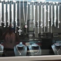 Terry s jewelry repair design jewellery 1609 n nova for Terry pool design jewelry