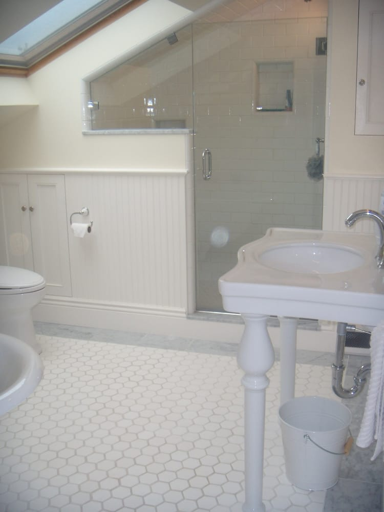 Bathroom Remodel In An Attic Remodel With Frameless Shower Enclosure Toilet Pedestal Sink