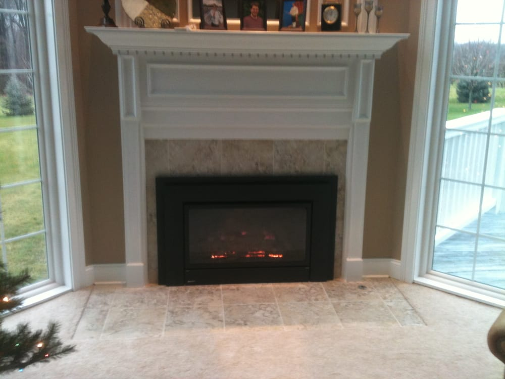 black carara marble fireplaces